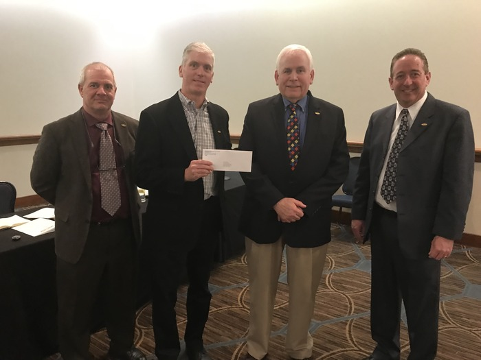 MCAO President, Tim Farber, thanks representatives from the Mechanical and Plumbing Industry Council, Jim Primozic, Tom Wanner, and Keith Willkomm for their generous PAC contribution.
